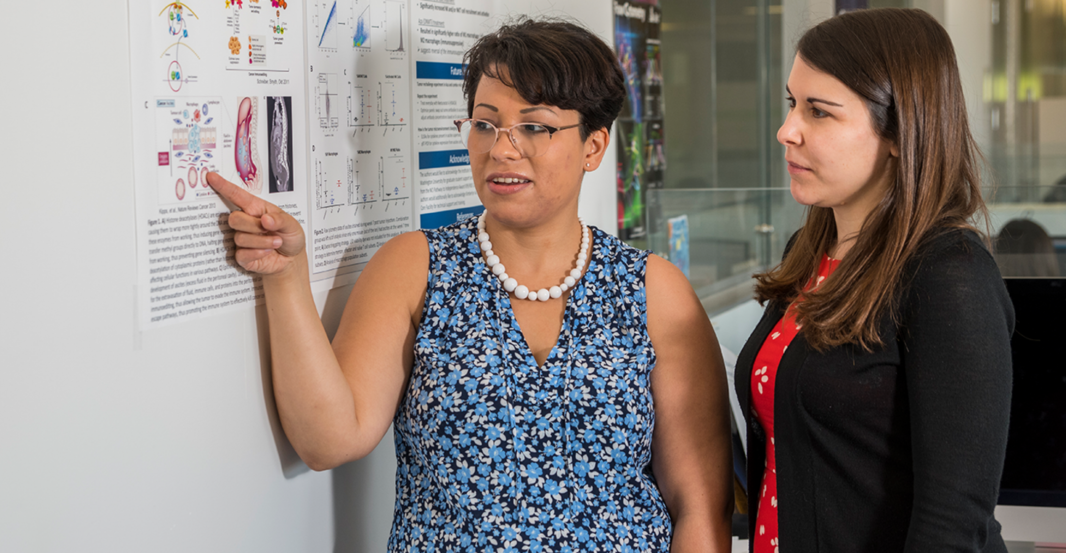 Kate Chiapinelli, PhD Looking at Research Days Poster Presentation