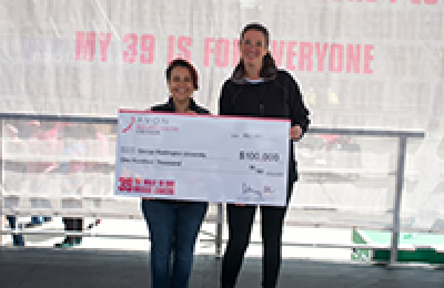 Mandi Pratt-Chapman, MA, accepted a check from the Avon Foundation