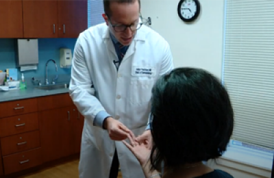 Dr. Friedman Sees a Patient in the Supportive Oncodermatology Clinic