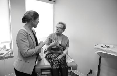 Christine Teal talks with a patient